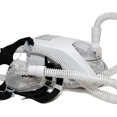 Gray and black CPAP machine isolated against plain white background