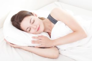 woman sleeping peacefully on pillow
