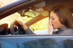 woman struggling yawning suffering from sleep apnea in Lawton