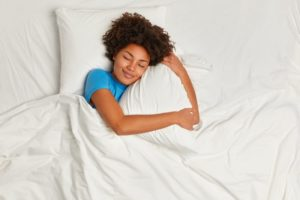 Woman with different types of sleep apnea in Lawton sleeping