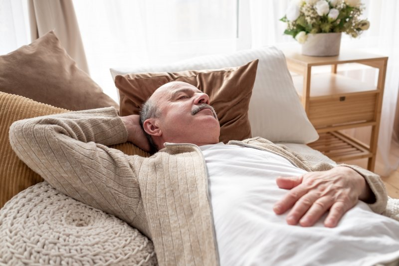 Man laying on his couch and napping